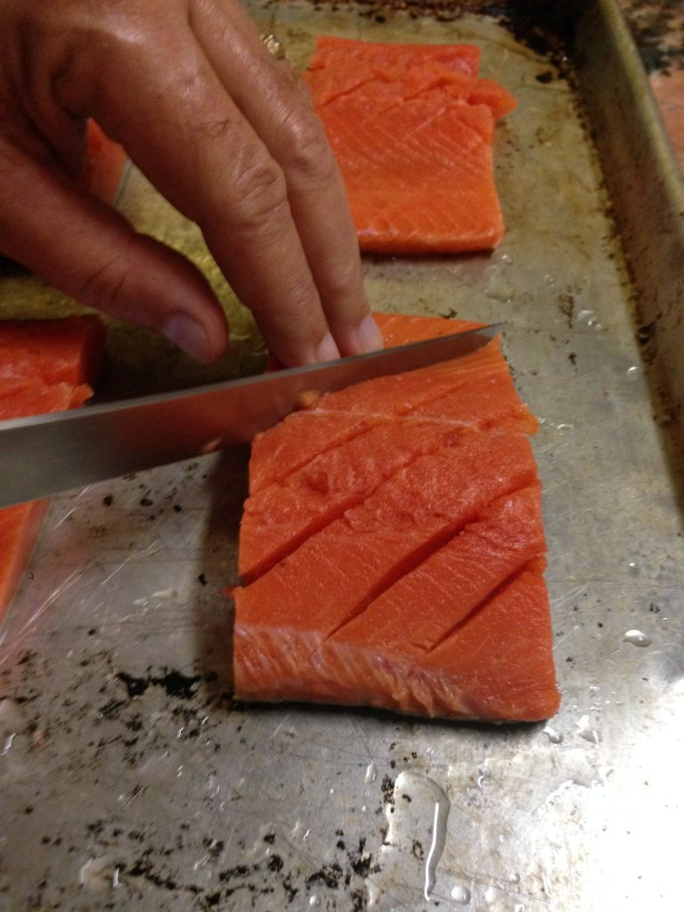 Fresh salmon  on tray prior to being cooked www.diningwithmimi.com