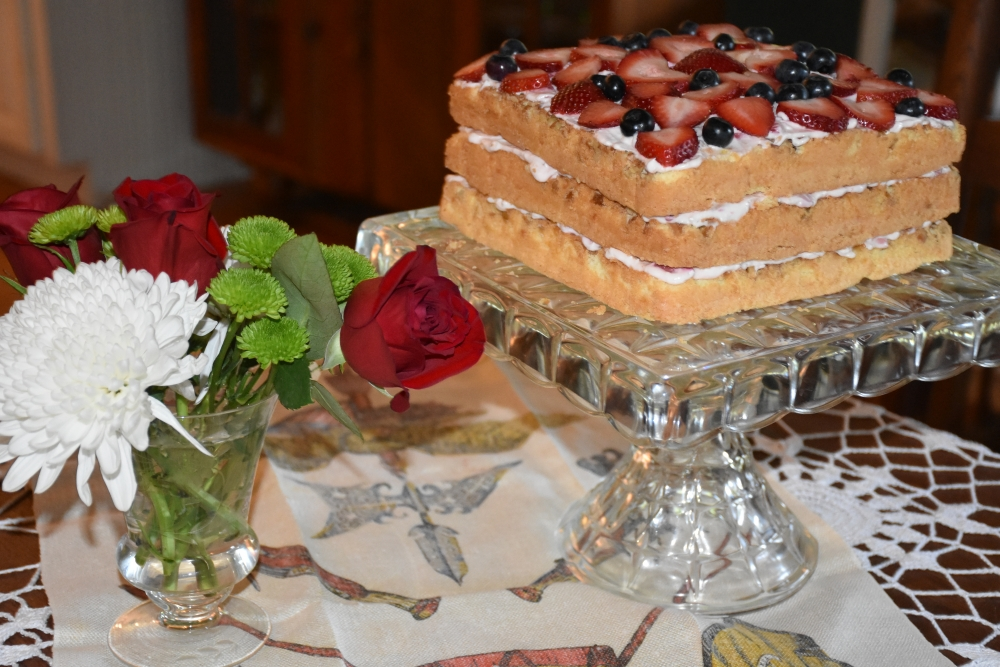 Triple layer light cake with creamy strawberry filling. Recipe at www.diningwithmimi.com