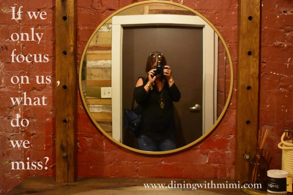 Photo of brick wall with reflection in mirror of photographer for April 2020 Hoda wan Kenobi www.diningwithmimi.com
